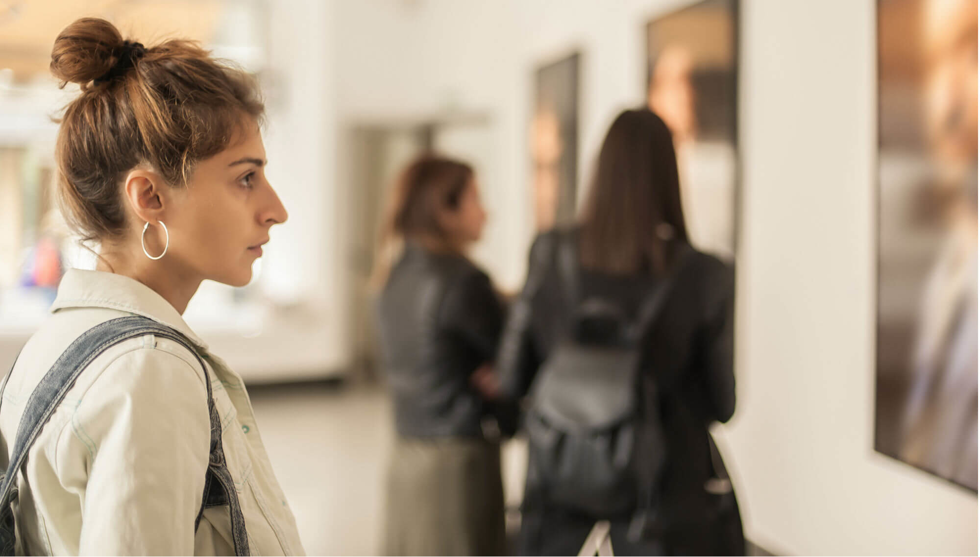 A woman looking at pieces at a museum