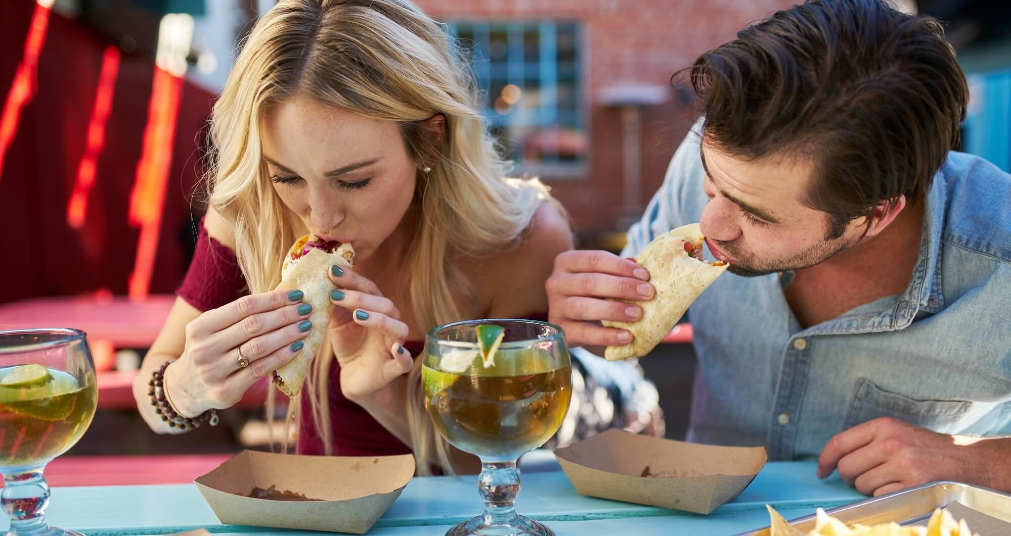 Couple eating tacos in East Nashville